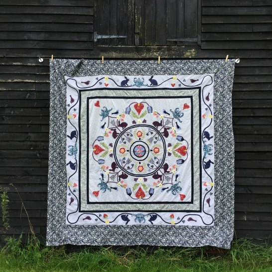 The William Morris Arts & Crafts Quilt ( based on the Ladies Work Society Coverlet in the Quilters Guild of the British Isles Collection)